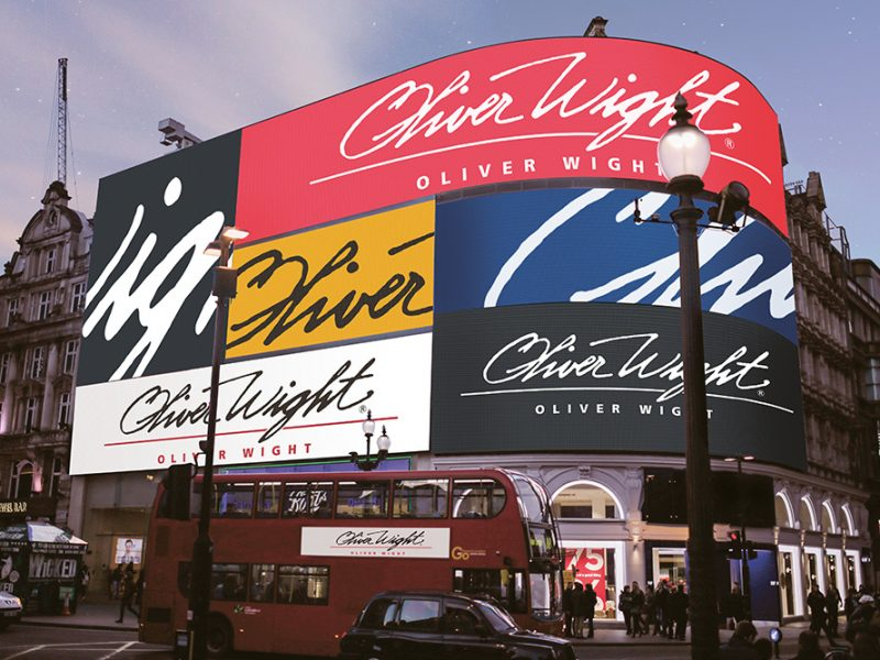 The Oliver Wight logo in picadilly circus billboard and bus